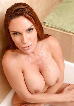 Busty MILF pornstar Diamond Foxx taking cumshot from large cock in bathtub
