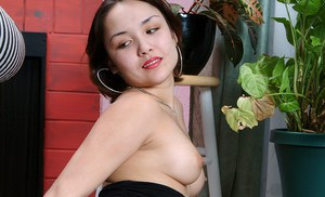 Tiny Asian amateur Sandy spreading labia lips after undressing