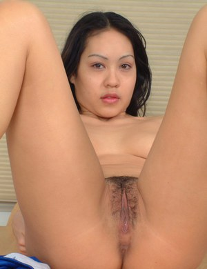 Brunette amateur Milla stripping off sports clothes to display Asian beaver
