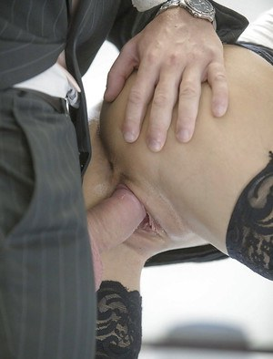 Brunette office worker Carolina Abril taking cumshot on pussy in stockings