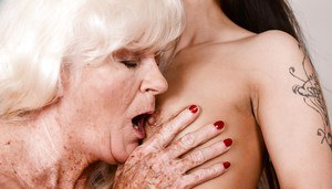 Fat grandma and younger brunette eat out each others lesbian pussy