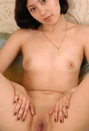 Amateur Asian brunette Elena revealing tiny boobs and shaved pussy