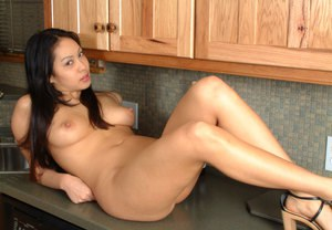 Pretty Asian first timer Milla stripping for naked kitchen spread