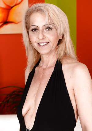 Hot blonde granny Ilona G loosing saggy tits from little black dress