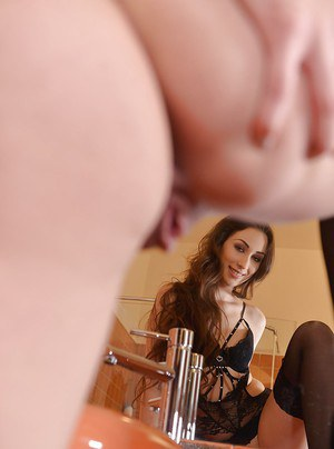 Euro chick Leyla Bentho uncovering nice ass in black stockings in bathroom
