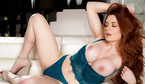 Girl with red hair Veronica Vain revealing large boobs and trimmed muff