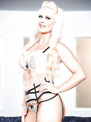 Platinum blonde pornstar stripping off lingerie to pose naked in stockings
