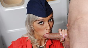 Tattooed blonde Kleio Valentien fucking large cock in stewardess uniform