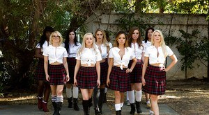 Schoolgirls strip off pleated skirts before having all girl orgy