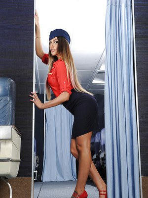 Leggy stewardess Abigail Mac unbuttoning blouse to expose nice melons