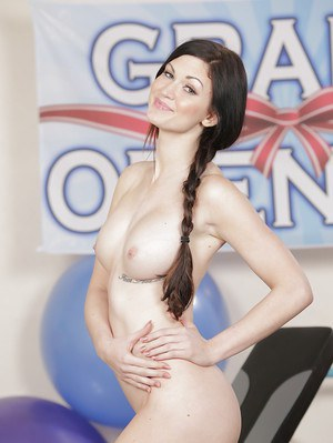 Pigtail attired Kendall Karson flashing big tits before posing in the nude