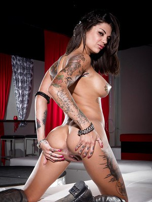 Tattooed brunette Dahlia Sky modeling naked in leather boots