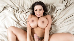 Fat brunette MILF Sheridan Love takes cumshot on huge tits and pierced nips