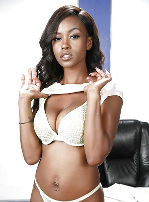 Busty black dime Jezabel Vessir stripping off lingerie to pose nude on desk