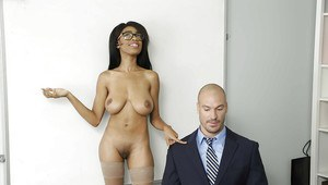 Black girl Brittney White displays large natural tits in nylons and glasses