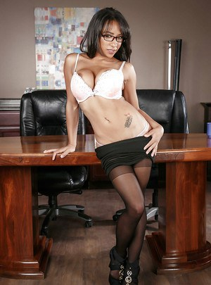 Ebony chick Priya Price revealing big tits in glasses and skirt at work