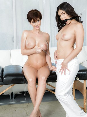 Lesbians Emily Addison and Violet Starr whip out strapon cock after massage