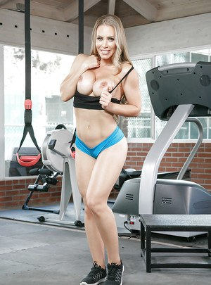 Fit pornstar Nicole Aniston revealing big boobs and bush in gym