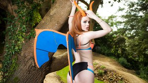 Redhead pornstar Ella Hughes flaunting juicy butt outdoors in cosplay garb