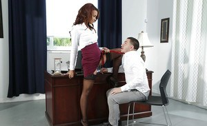 Pornstar Raven Redmond dripping cum from mouth onto big teen tits in office