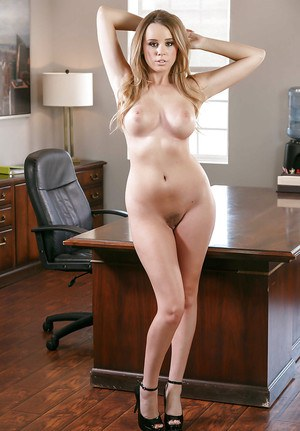 Clothed pornstar Alexis Adams revealing big natural tits on office desk