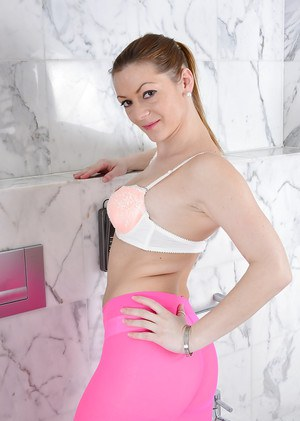 Older solo model Mischelle removing pink pantyhose from ass in bathroom