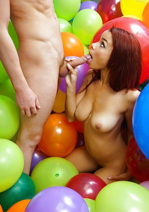 Teen coed Alice March giving oral sex in balloon filled dorm room