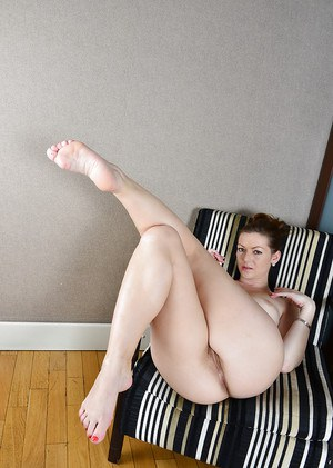 Older solo model Mischelle displaying hairy pussy in mesh bodystocking
