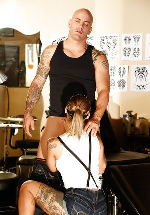 Tattooed MILF Kleio Valentien giving clothed blowjob in shorts