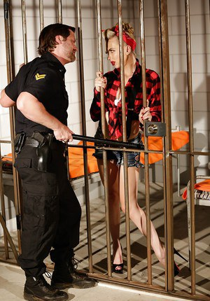 Clothed chick Jeanie Marie giving jail guard oral sex in retro garb