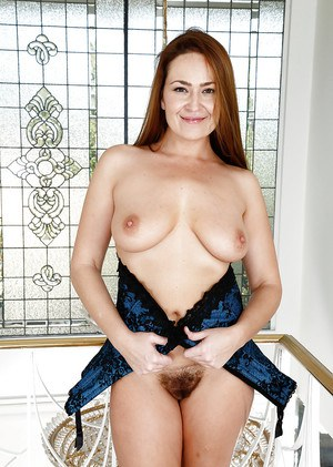 Redheaded MILF Elexis Monroe showing off nice ass and hairy cunt in heels