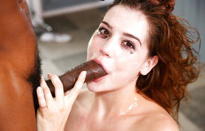 Naked young girl has gigantic black cock shoved all the way down throat
