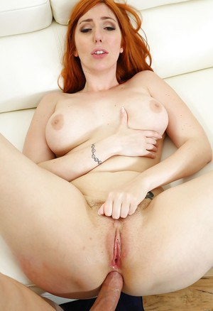 Redheaded pornstar Lauren Phillips taking anal penetration from large dick