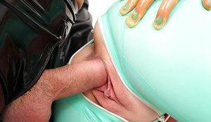 Kinky nurse Latex Lucy taking cum in mouth after banging man in rubber mask