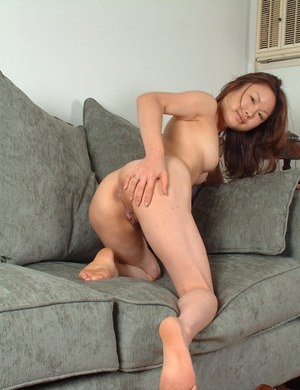 Asian first timer Lilianna removing high heels from bare feet
