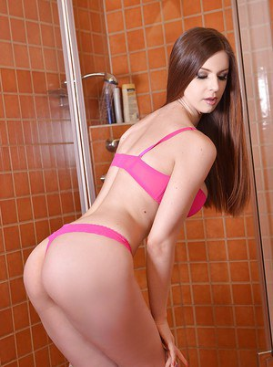 Clothed Euro pornstar Stella Cox displaying nice tits and ass in shower