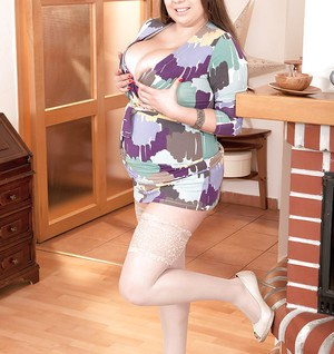 Plump solo girl Monica Love exposing hooters in high heels and stockings