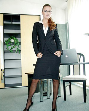 Clothed MILF pornstar Claudia Rossi strips off secretary garb to pose naked