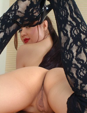 Beautiful Oriental model Angelica posing seductively in sexy stockings