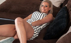 Clothed MILF Alana Luv slipping up skirt panties aside to expose pink pussy