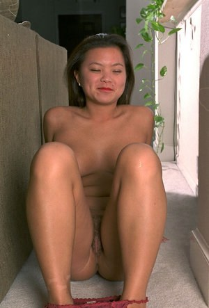 Asian first timer Tina revealing firm natural tits while undressing