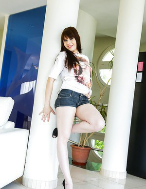 Brunette teenager Luna River modeling in shorts while baring in public mall