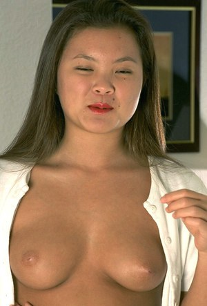 Fresh faced Asian Tina revealing nice first timer tits and hairy muff