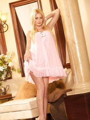Blond MILF Riley Steele stripping off baby doll lingerie to expose big tits