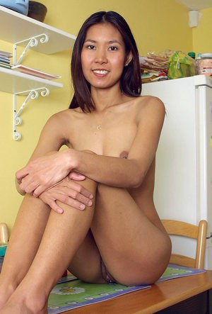 Asian first timer Luxi pulling down white cotton panties to expose beaver