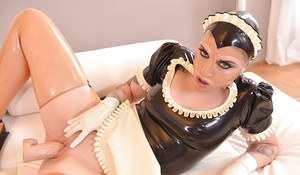 Latex attired maid Mary Jale pisses on floor before jamming big toy in twat