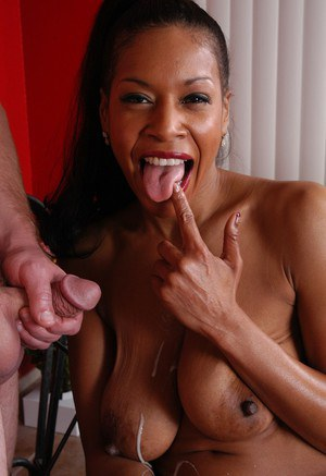 Mature ebony lady Semmie eating sperm after cumshot on huge black boobs
