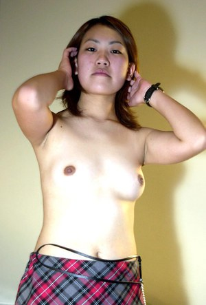 Asian first timer Naoko revealing tiny tits and bush in white stockings