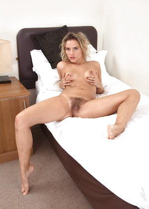 Dirty blonde model Regina opening sexy legs to display hairy snatch