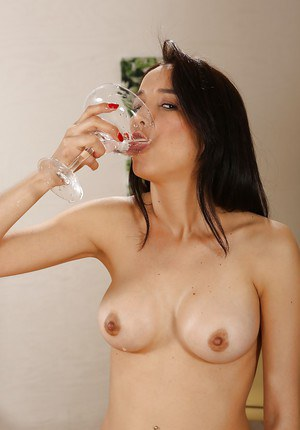 Dark haired Latina Francys Belle drinking own pee after pissing into glass